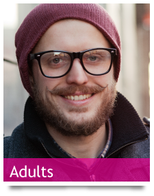 btn-adult - young adult in glasses and a moustache